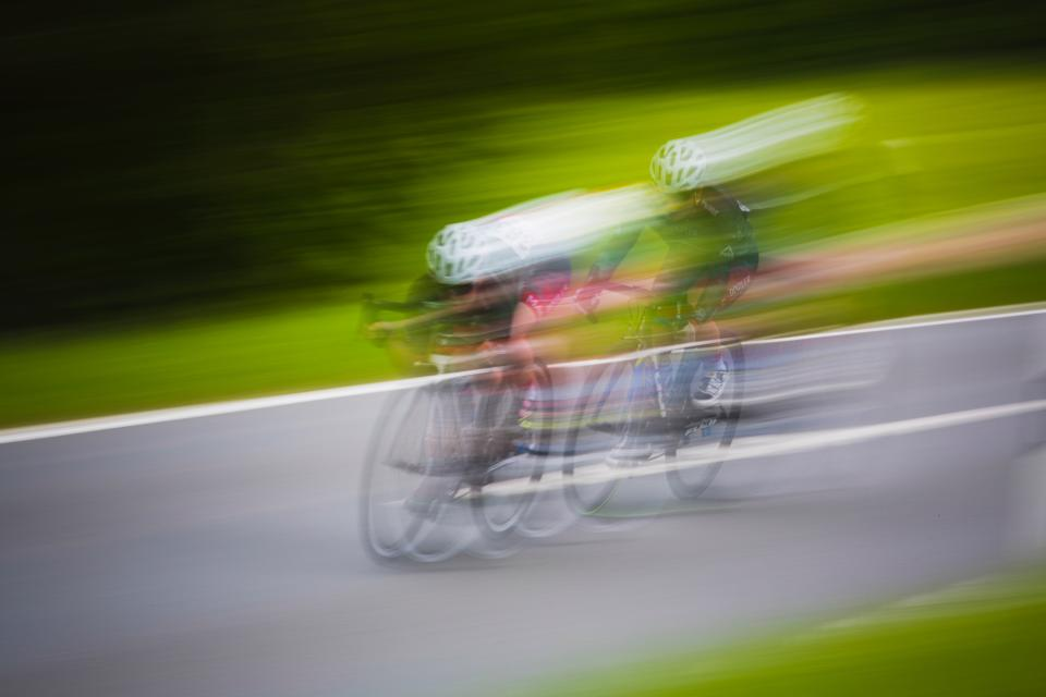 bike bicycle cyclist sport game racing speed road blur