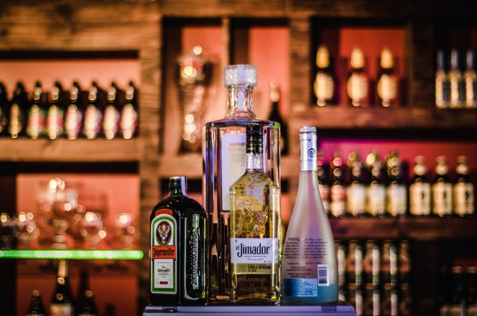 bar liquor bottles beverages wine alcohol bokeh blur cabinet display