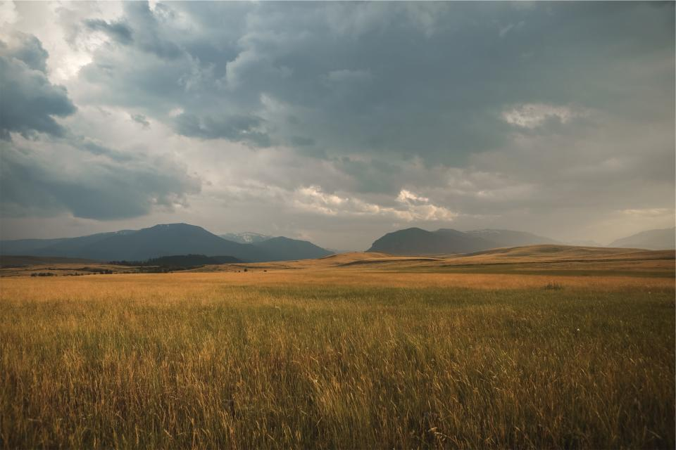 landscape storm clouds cloudy fields grass mountains rural plains