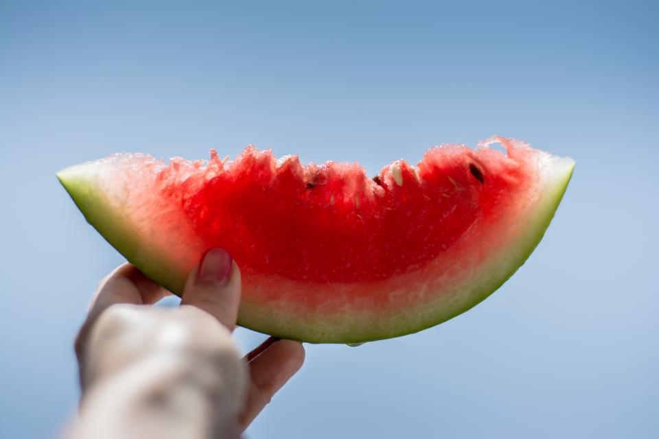 watermelon fruit fresh juicy health food hand blue sky