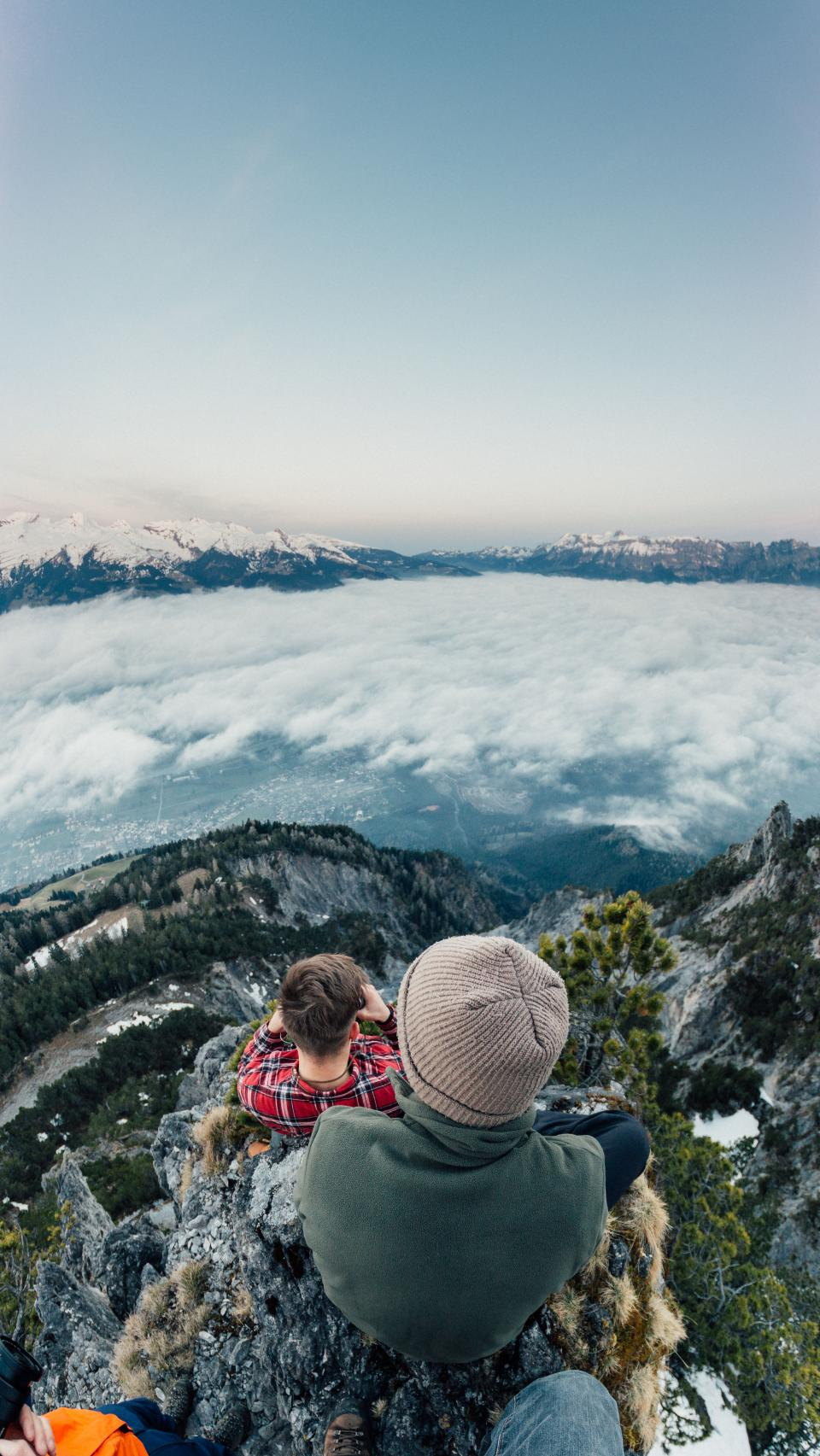 mountain highland cloud sky summit ridge landscape nature valley hill snow winter view travel trees people outdoor adventure hiking climbing girl man millennials