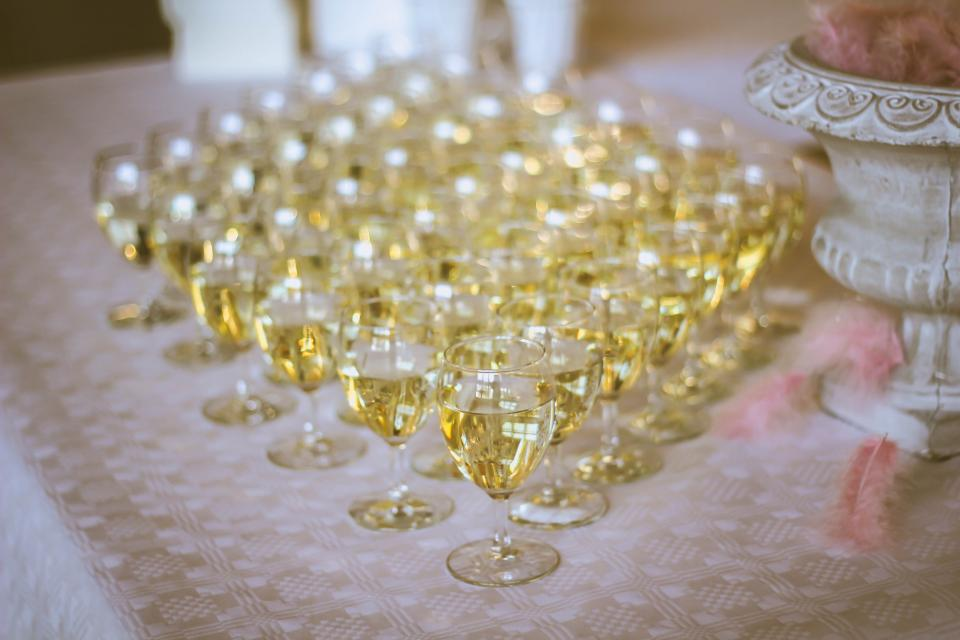 white wine glass drink beverage party table