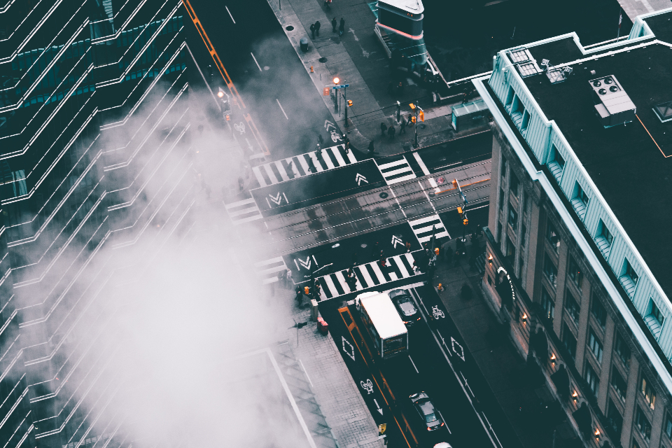 fog city architecture street crossing cloud rain building business cars downtown emergency fire outdoors pavement road smoke traffic transport travel vehicles