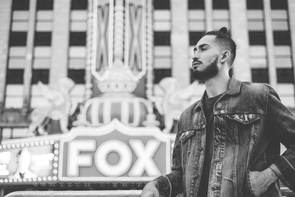 people man guy millenials places landmarks fox theater black and white grayscale
