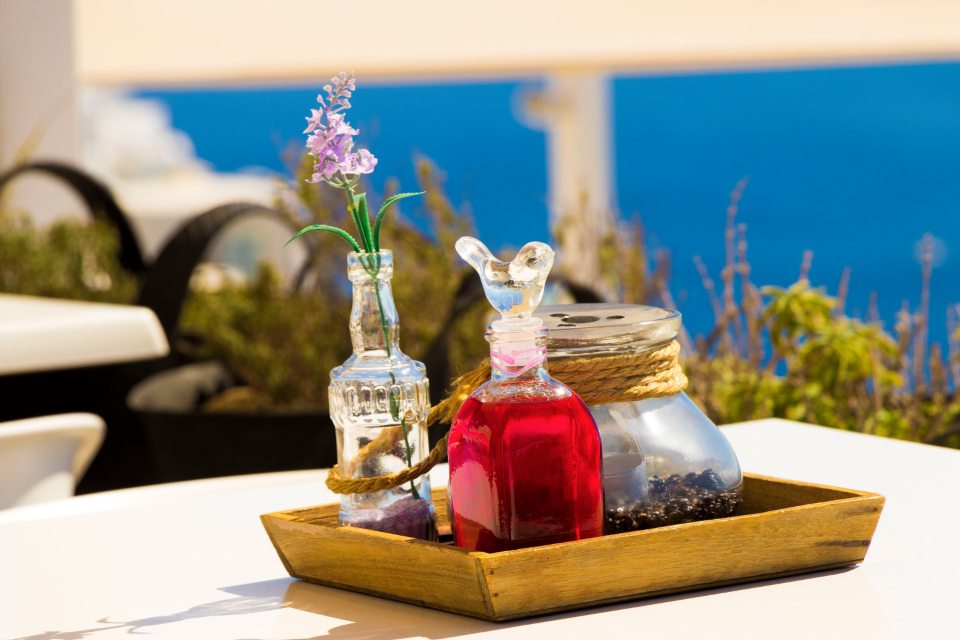 Santorini greece relax travel table glass vase flower restaurant