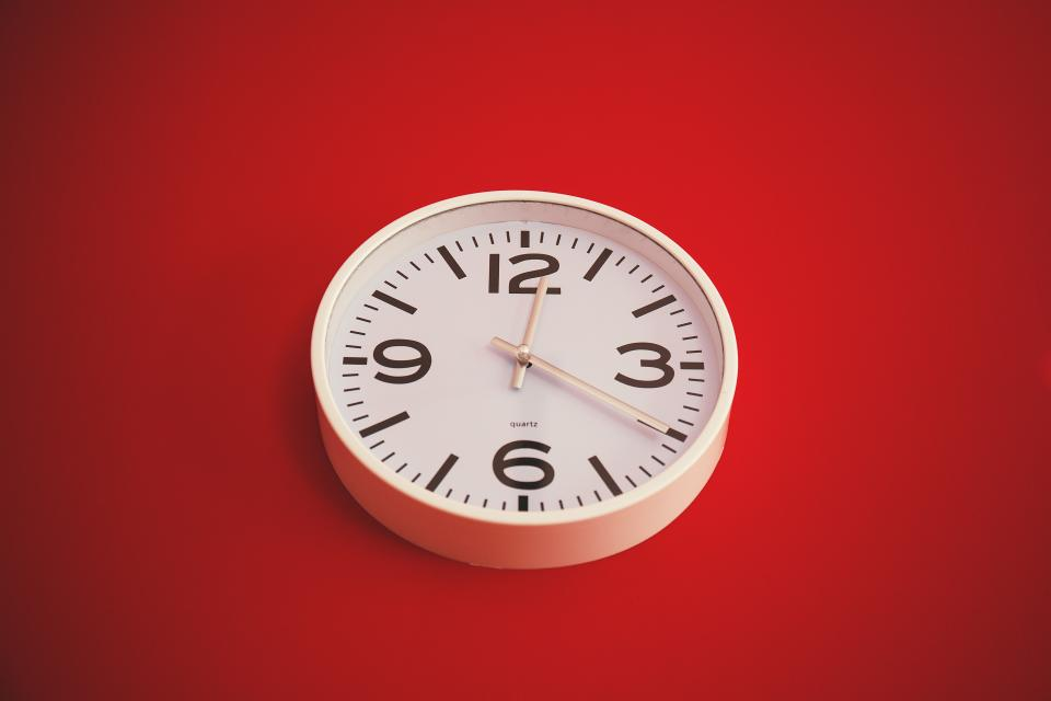 clock time numbers red wall