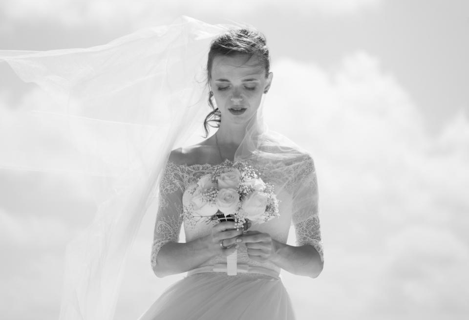 people woman black and white monochrome wedding bride flowers bouquet dress clouds sky face marriage