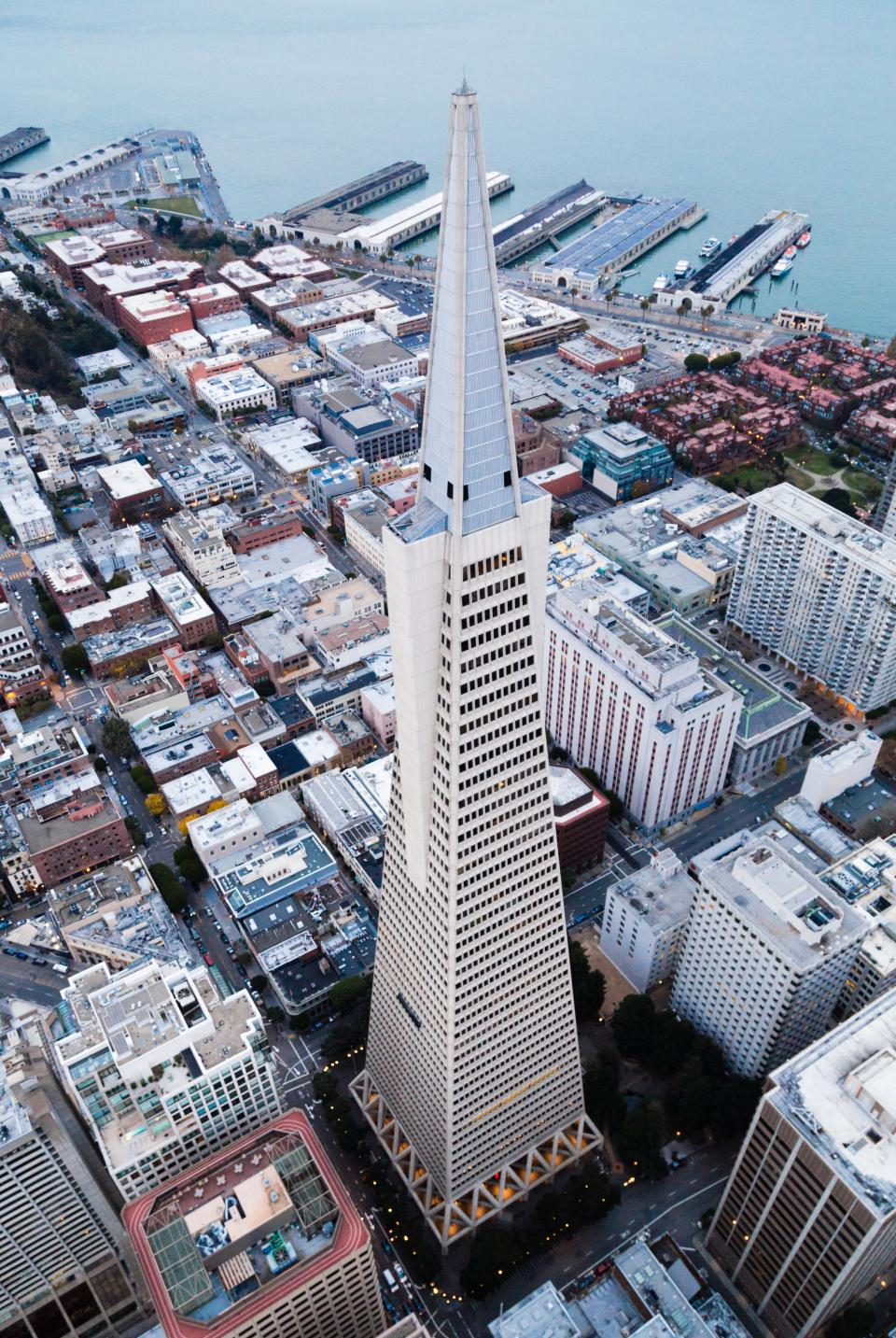 architecture buildings infrastructure sea water tower city skyline road street car vehicle travel aerial view