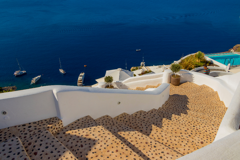 Santorini Greece amazing view steps stairs blue water ocean sea coast vacation travel trip luxury pool boats yachts