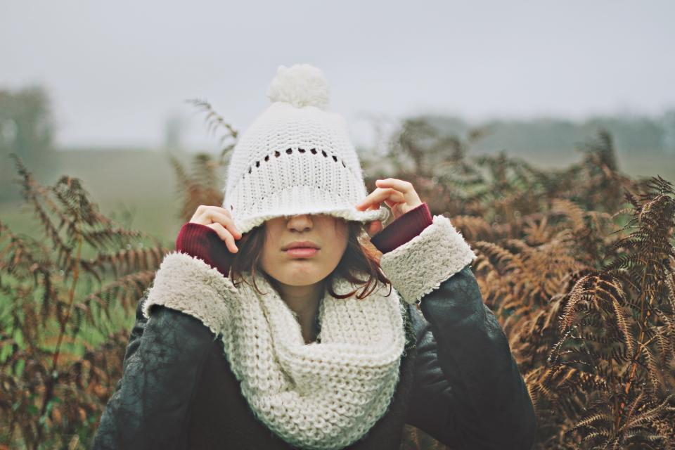people woman bonnet jacket cold weather leaves green autumn fall trees