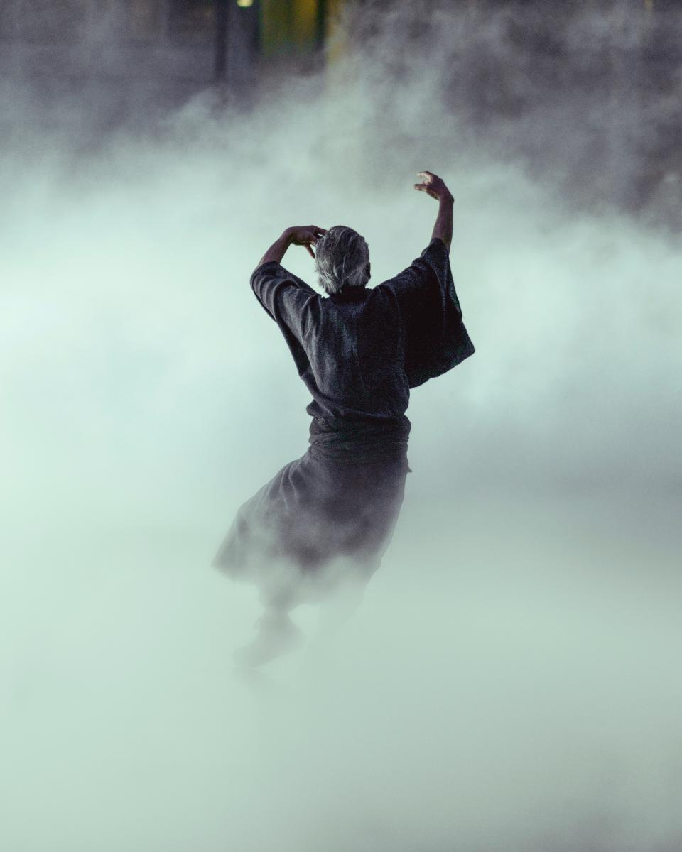 people man run dancing rain fog water