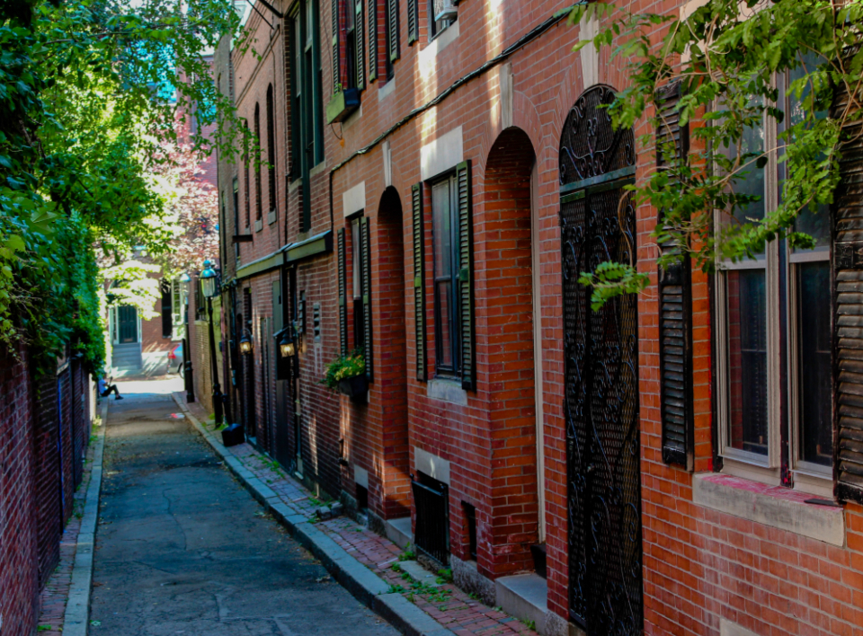 alley city street downtown brick buildings exterior urban architecture narrow windows doors old neighborhood