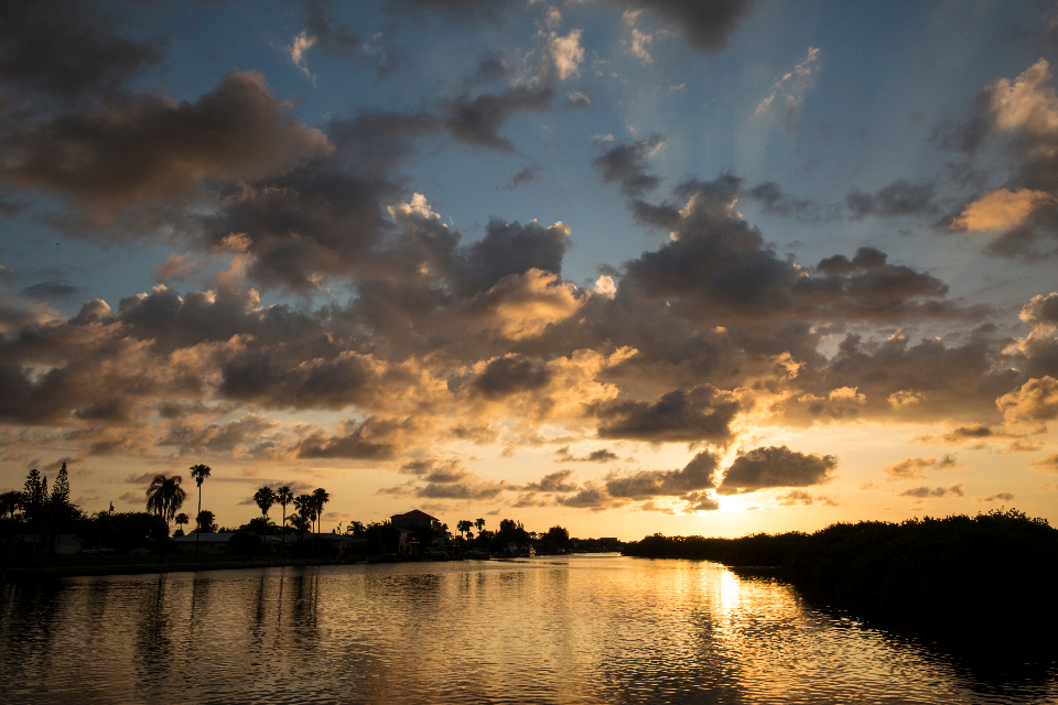 sunset clouds sky florida sun clouds dramatic sky evening dusk water reflection river