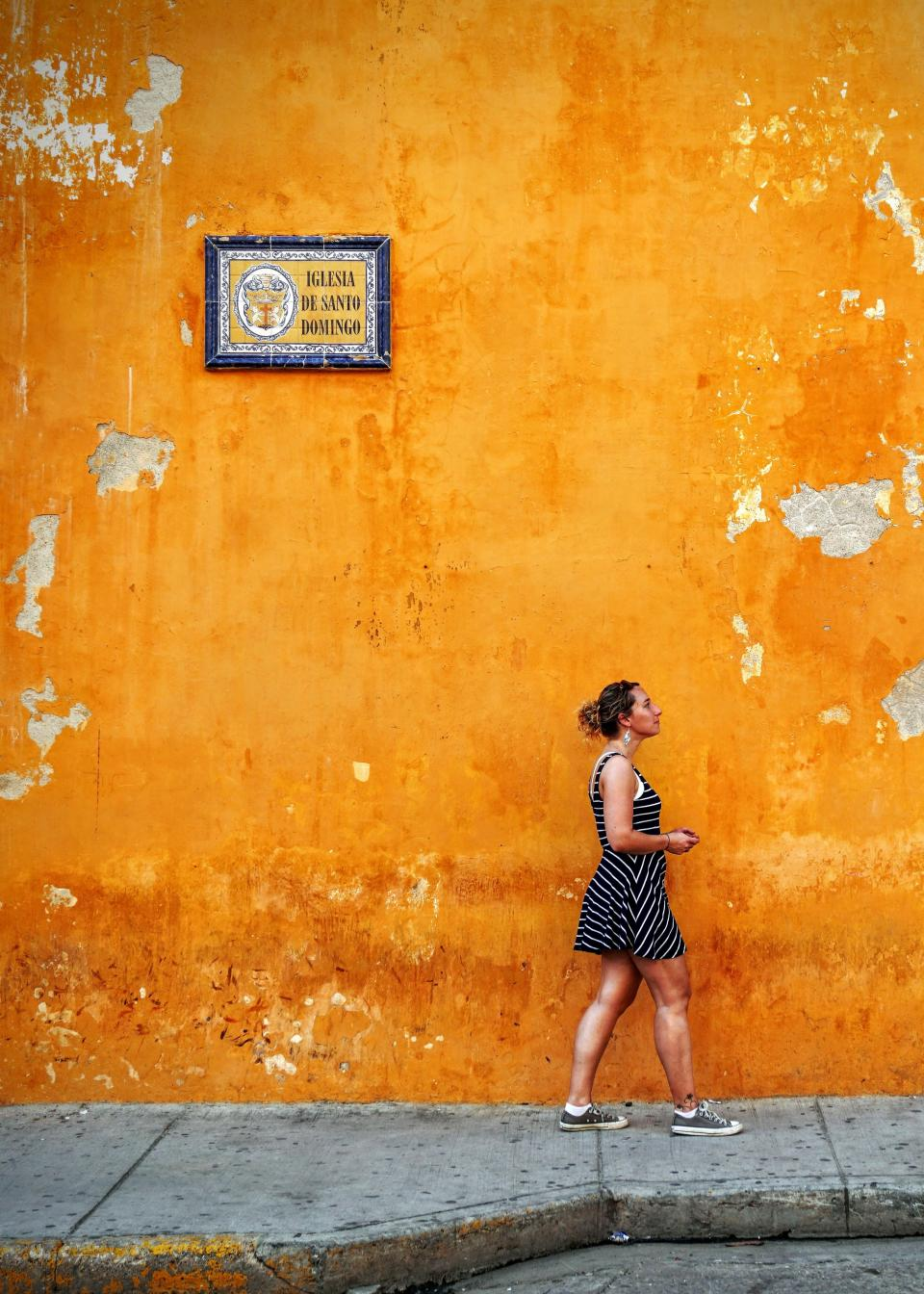 people woman street orange color wall sidewalk frame travel