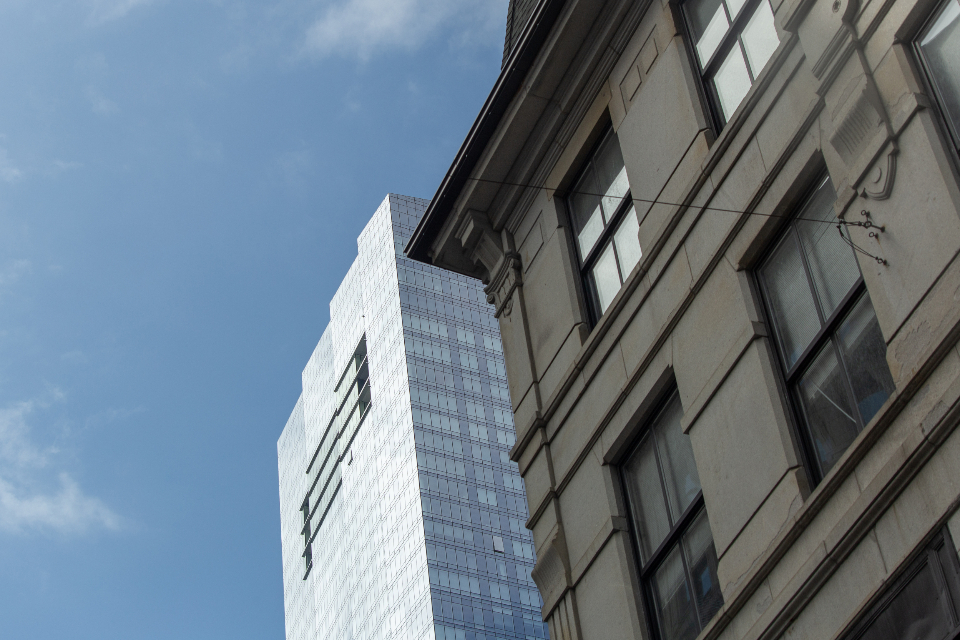 tall building city downtown windows architecture glass style exterior office sky clouds business angle