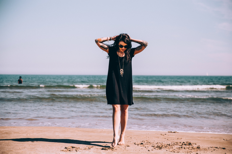 woman beach tattoo person vacation relax water waves ocean sea sand shore coast travel summer