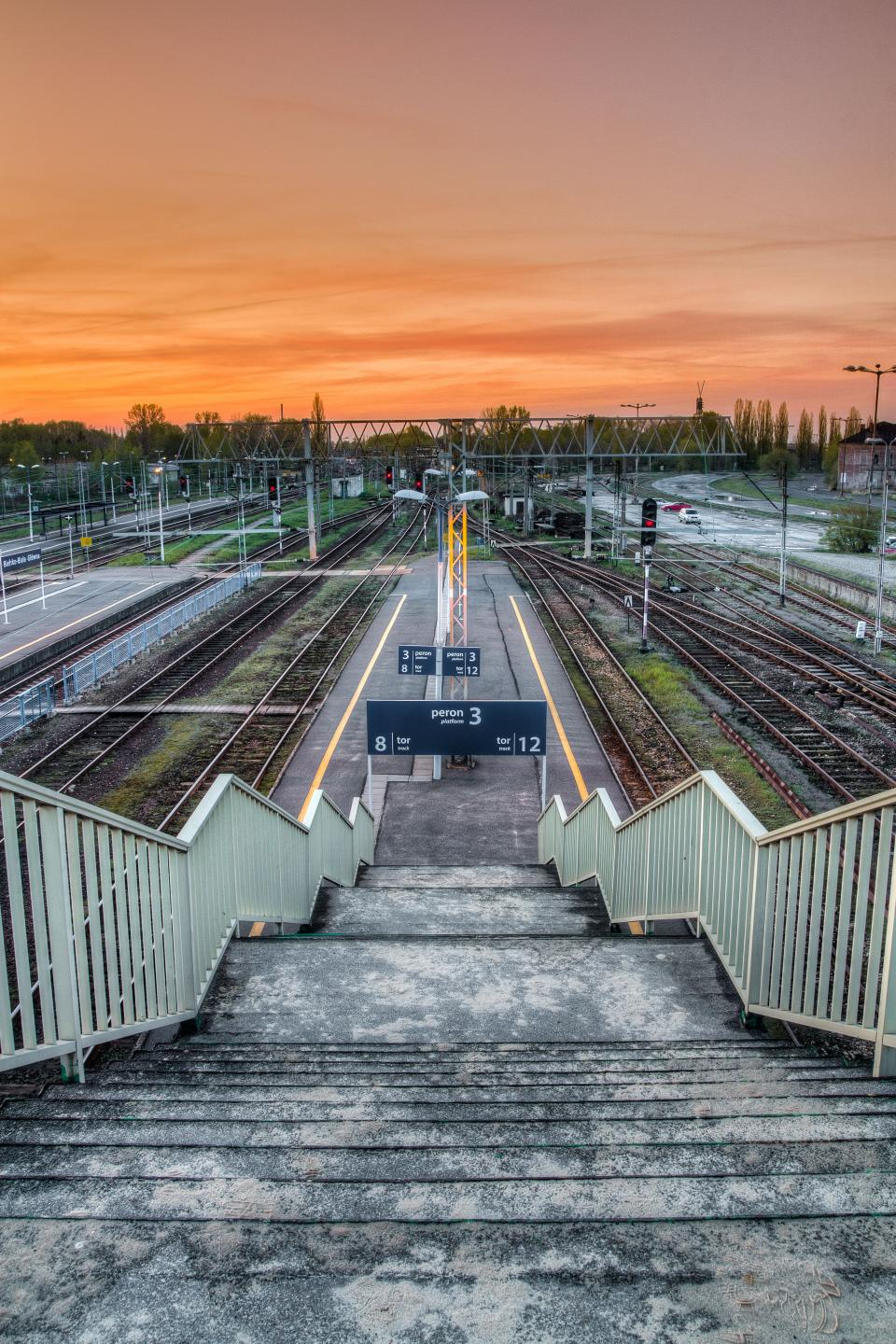 railway track outdoor travel station sunset sky stairs stoplight