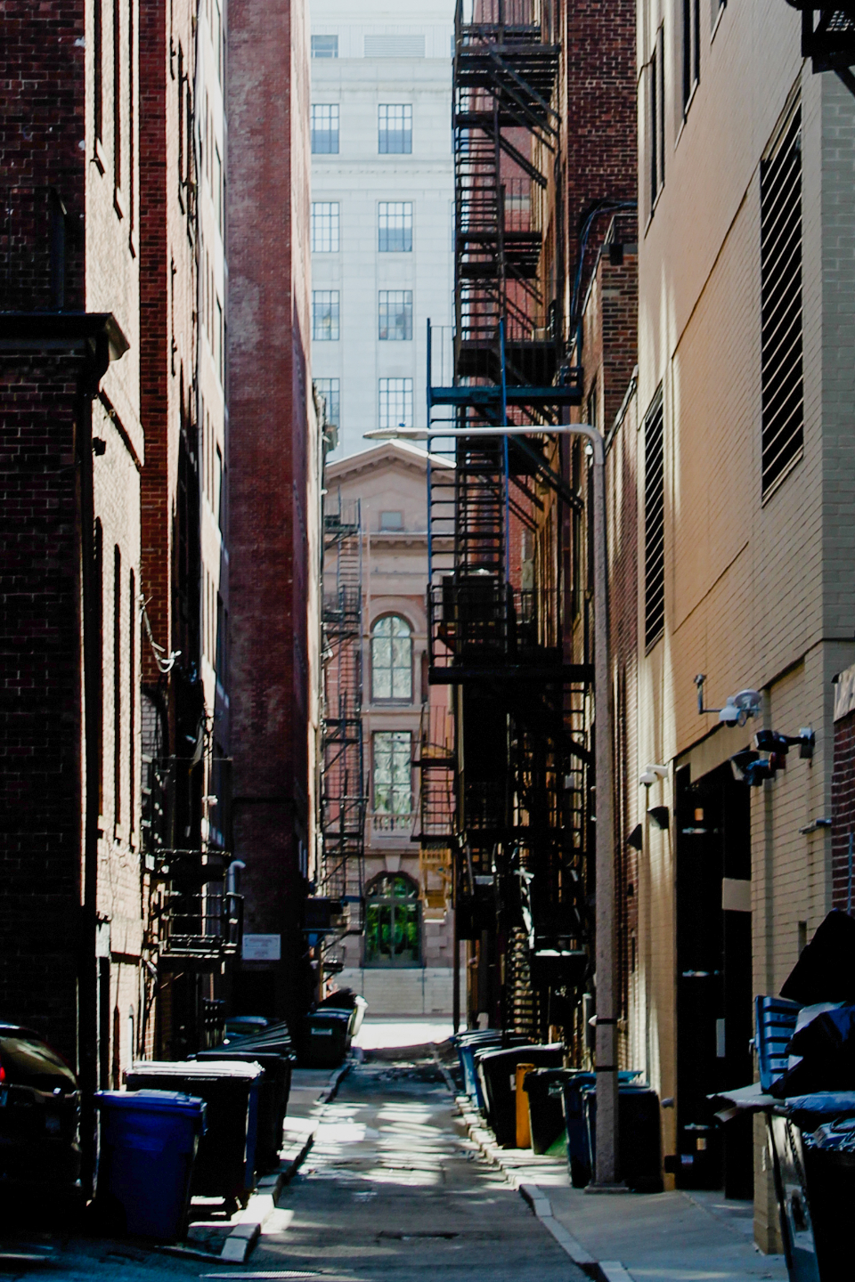 city fire escape buildings alley windows apartments brick tall stairs narrow exterior architecture urban downtown trash