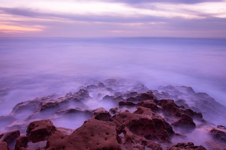 sea ocean water nature rocks coast sunset horizon clouds sky