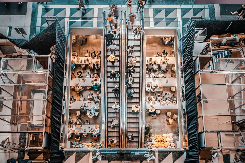 architecture building structure aerial view restaurant people eating escalator shopping mall