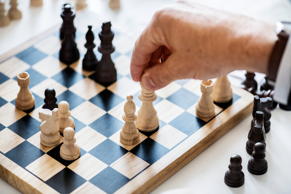 business strategy challenge chess closeup competition decision english european game german hands help horse isolated on white king mind game movement moves performance person planning playing q