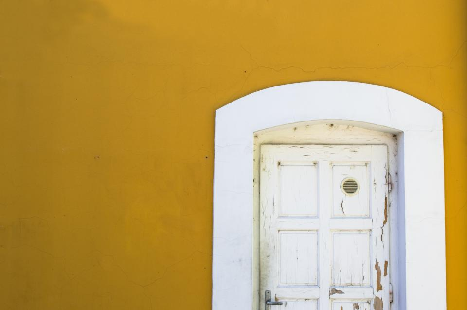 still houses homes walls door frame decrepit old wood chipped paint white yellow minimalist