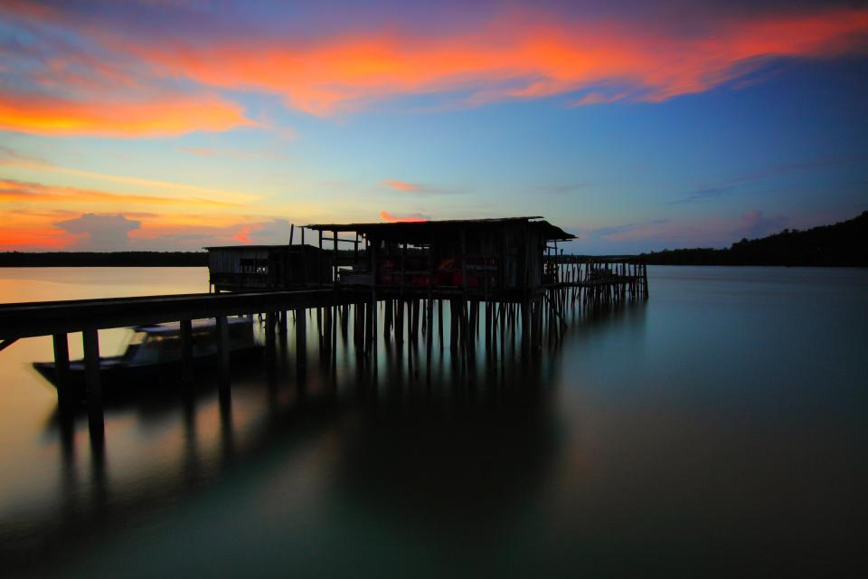 sea water ocean sunset cloud sky nature house outdoor view boat