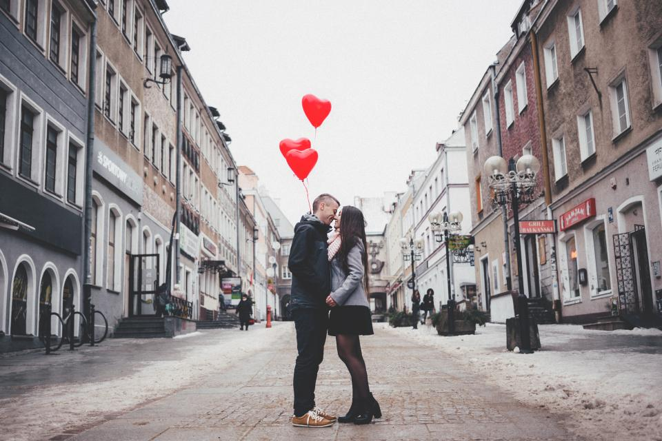 people man woman couple love affection intimacy heart valentines road street urban city architecture building establishment balloons shop store