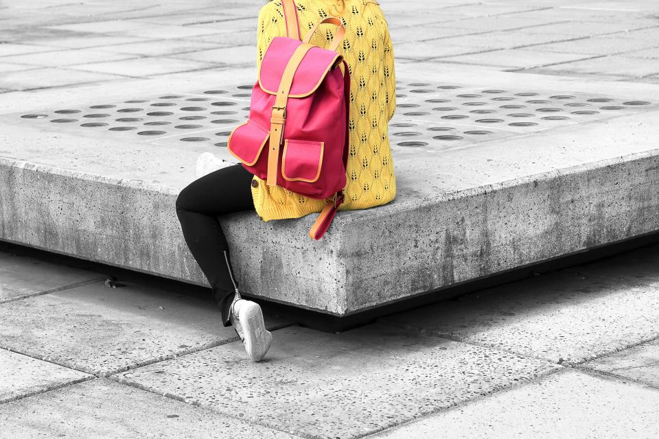 fashion travel woman girl female lady yellow pink backpack bag sweater jeans concrete city urban lifestyle student