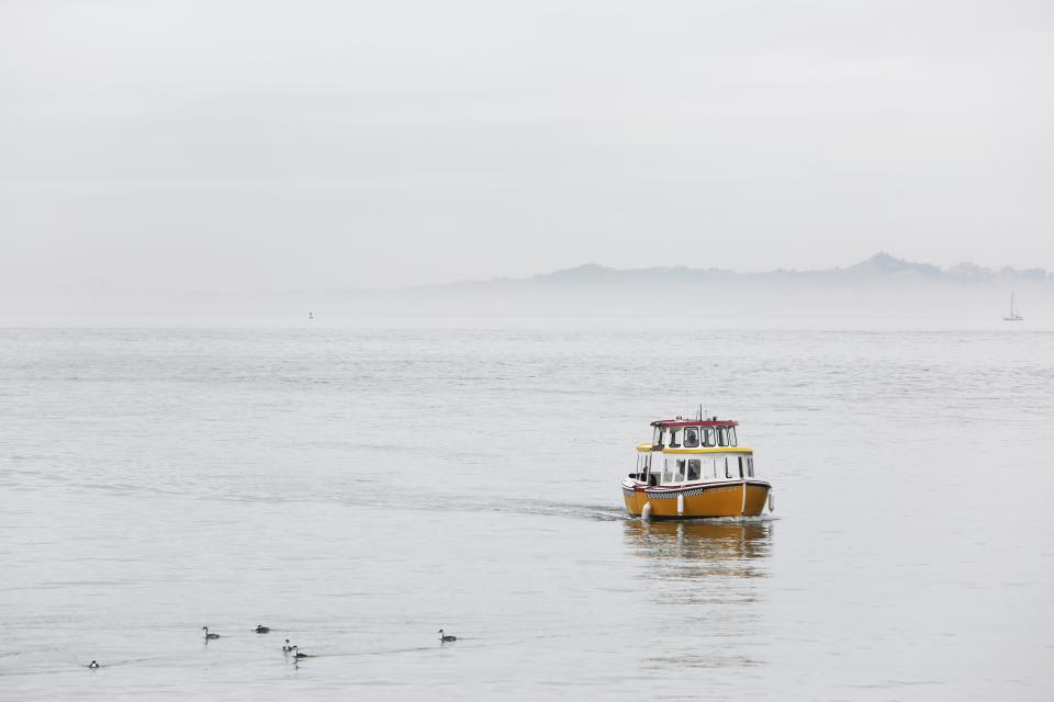taxi boat ocean sea lake water cloudy sky grey landscape nature