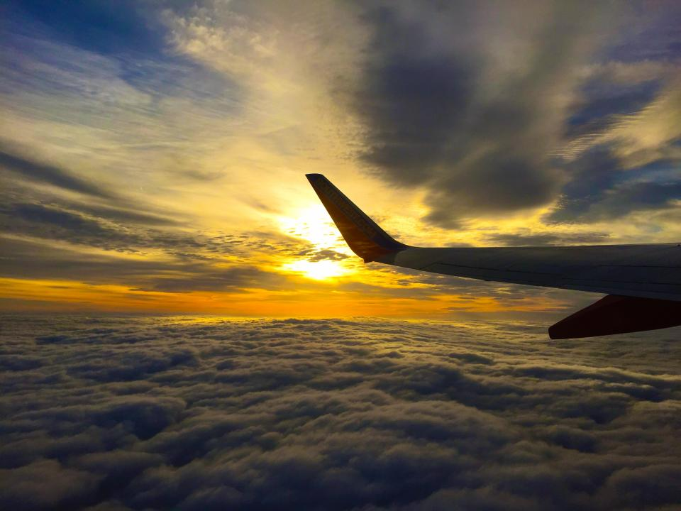 airplane travel trip flight clouds sky sunset sunlight nature view