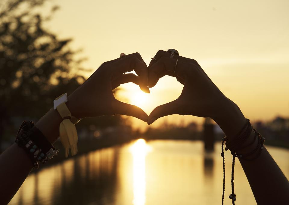hand heart bracelet fashion accessories silhouette sea water reflection sunset outdoor landscape view