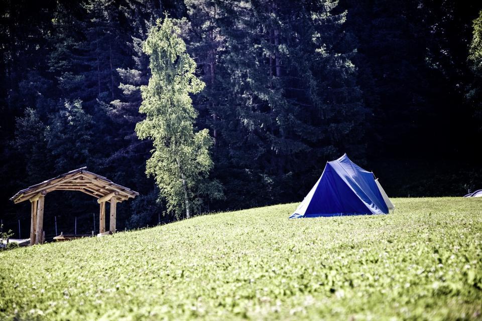 green grass highland grassland landscape nature mountain hike travel outdoor trees plant hut tent camping