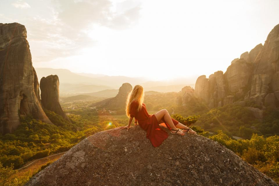 highland mountain hill landscape green grass travel view outdoor nature sky cloud sunlight sunshine sunrise rocks cliff landscape people woman girl alone