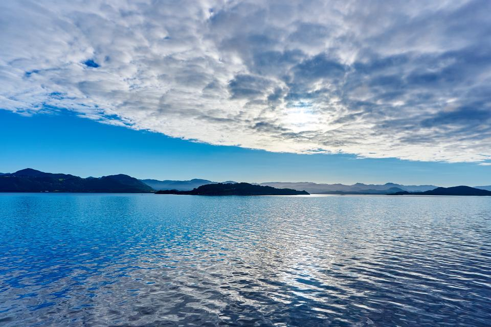 lake water sunshine blue sky clouds landscape nature mountains
