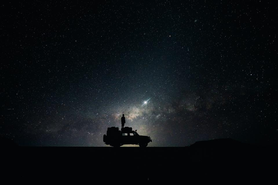 people man camping ride car transportation vehicle galaxy stars silhouette night dark astrophotography photography
