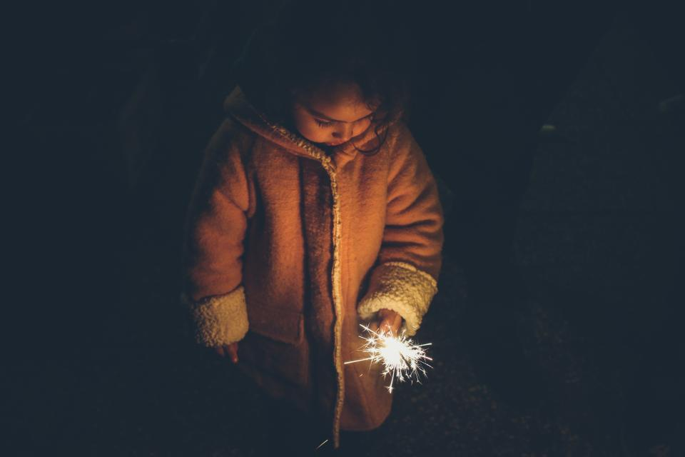 people kid child cold night dark jacket fireworks fire spark light