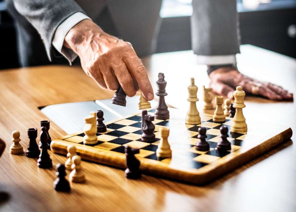 achievement adult battle black board business businessman check chess chess piece chessboard choice competition conflict decisions defense focus game hand horse king knight leadership management mate moving pieces plan