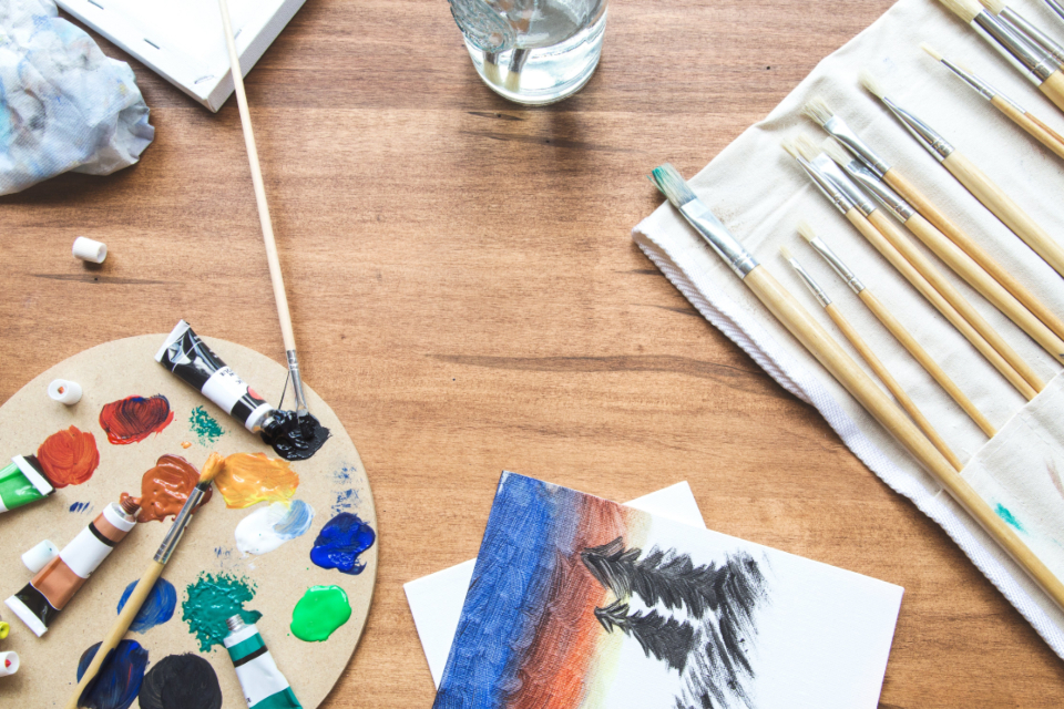 paint supplies desk art creative design flat lay woodgrain brush canvas acrylic water colorful studio artistic texture