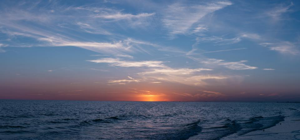 nature water ocean sea wave ripple sky clouds horizon sunset sunrise dusk dawn sun rays light blue purple
