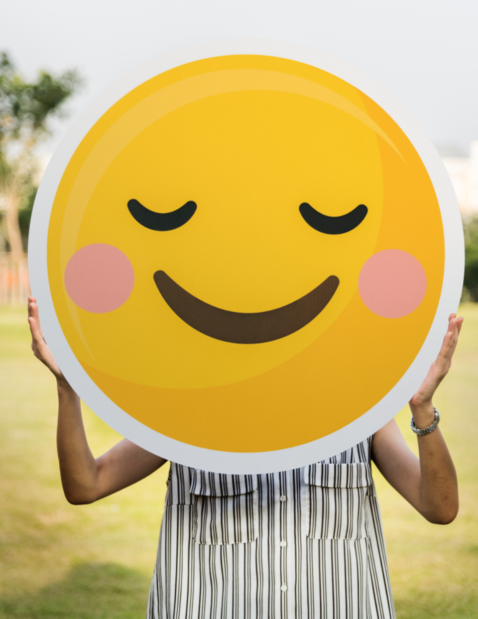 carrying cartoon emoji emoticon expression face field fun happiness happy happy face holding icon joy joyful korean malaysian outdoors paper park smile smiley smiley face smiling f