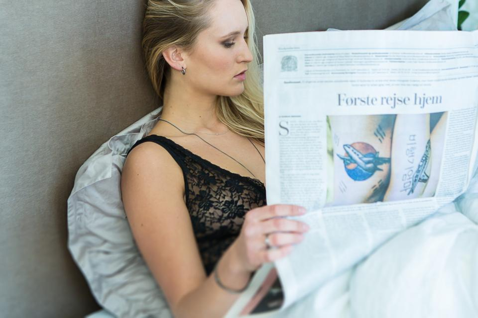 people girl woman lady female sitting relax reading newspaper