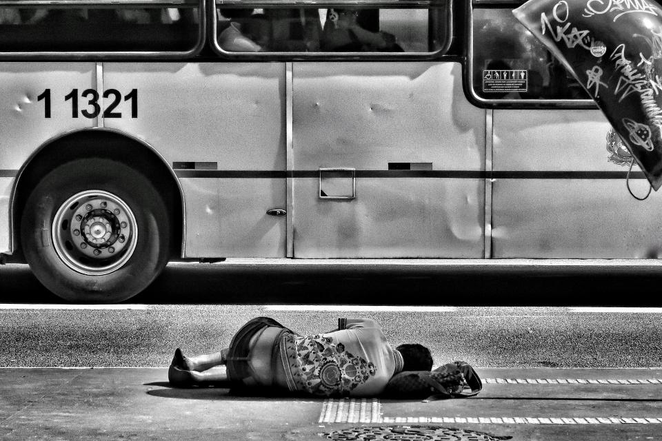 road street vehicle bus transportation people sleeping poor homeless