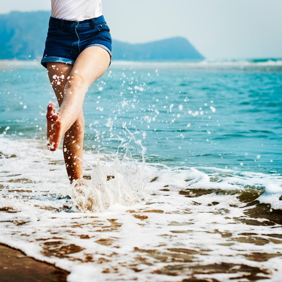 stomp feet people woman happy waves ocean sea adventure travel vacation happy blue beach