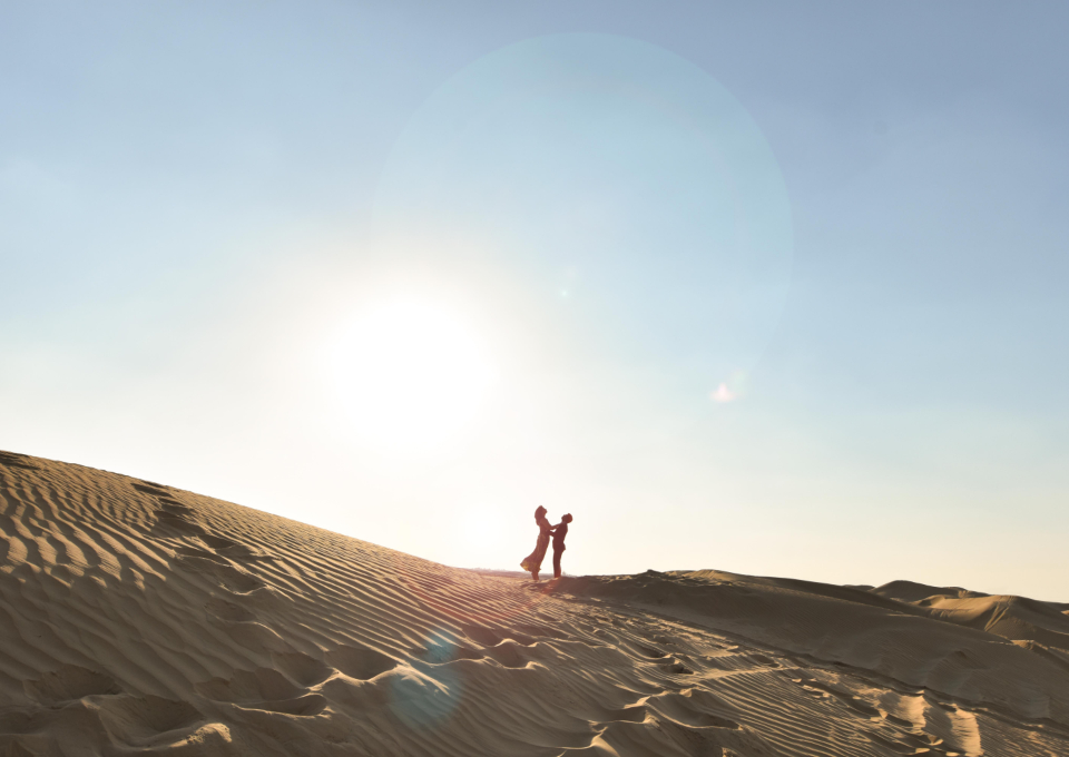 couple love cuddle people person man woman girl female male sand dune desert blue sky