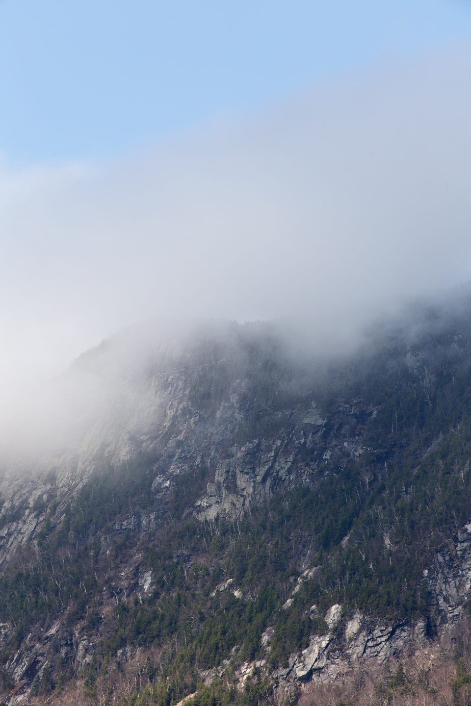mountain landscape terrain climate nature outdoors environment weather clouds rocky mist fog sky