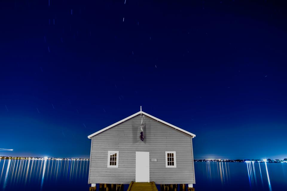 house home water lights blue night sky