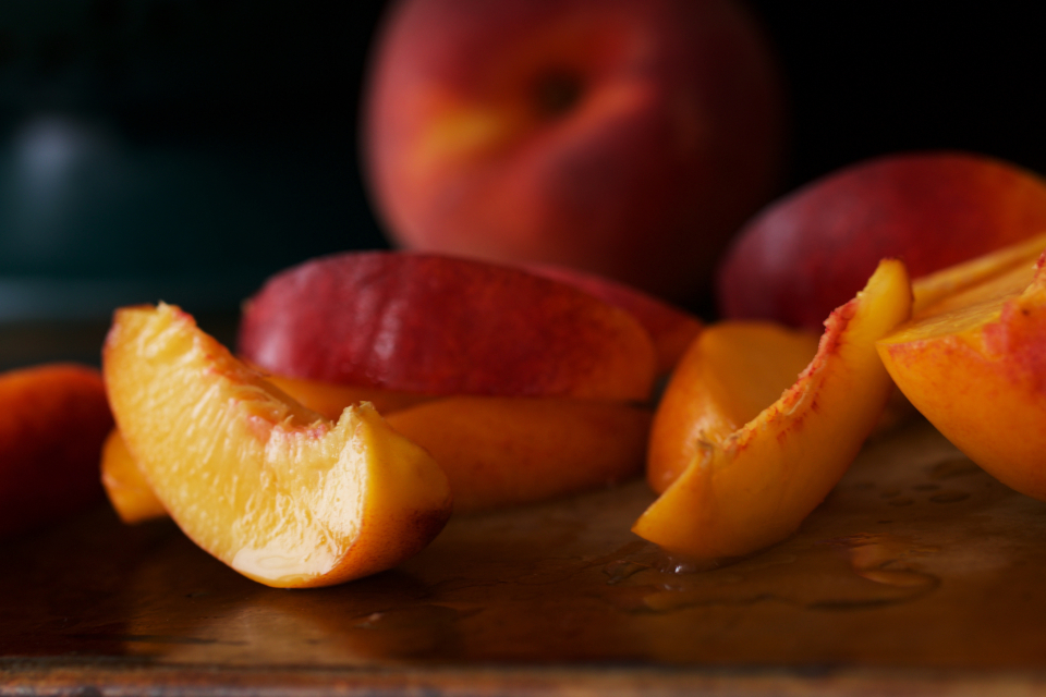peaches fresh fruit slices organic sweet close up juicy healthy nutrition rustic eating food snack