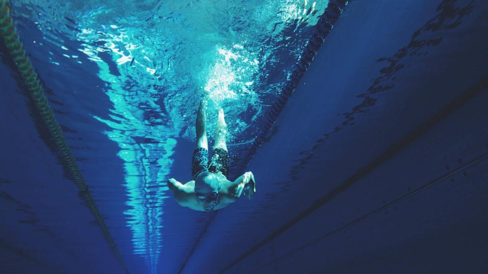 swimming diving water blue pool underwater athlete swim swimmer diver goggles pool sports fitness health