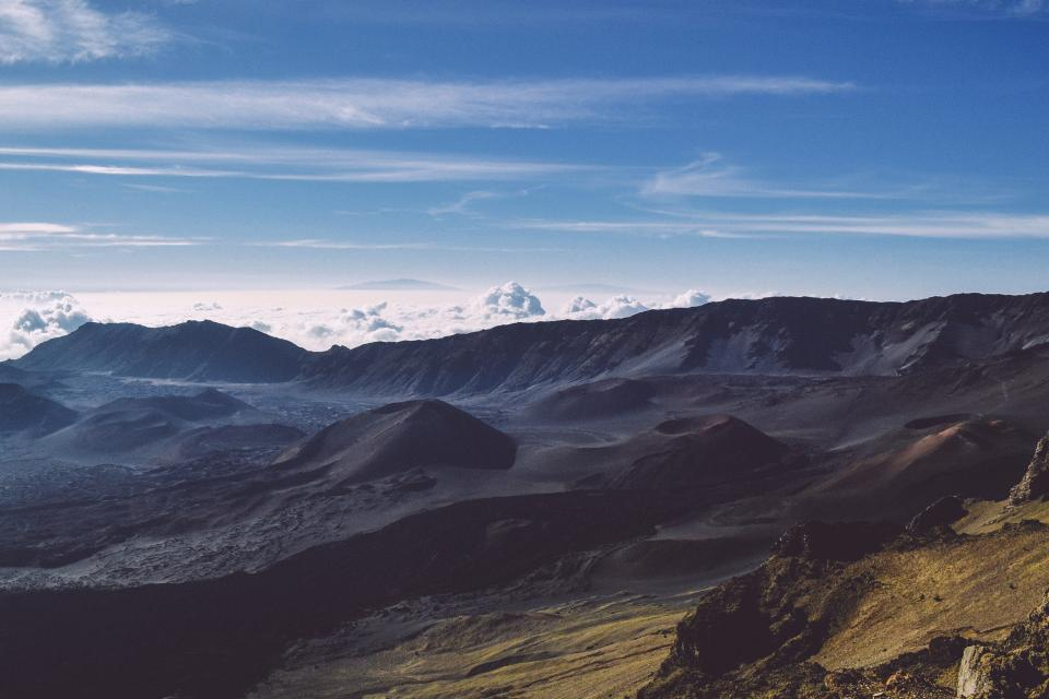 nature landscape mountains summit peaks rocks ground soil sky horizon clouds gradient shadows silhouette blue gray brown